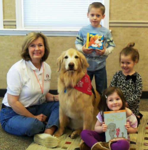 "A few of the beautiful children who attended ""Reading to the Dogs"" program at the Lee County Public Library on Saturday morning.  Each child (and/or Mom and Dad) would sit with us on a quilt on the floor and read to Bear, who I must say was very attentive!"