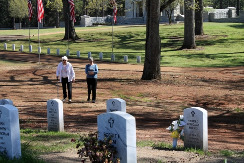 Kay and Donna walk toward the section where Joe is interred.